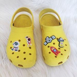 Yellow Crocs with Astronaut & Space themed Jibbitz